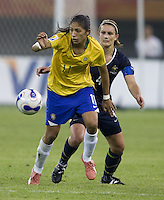 Brazil forward (11) Cristiane is chased by Australia defender (4) Dianne Alagich. Brazil defeated Australia, 3-2 during the quarterfinals of the FIFA Women's World Cup at Tianjin Olympic Center Stadium in Tianjin, China on September 23, 2007.