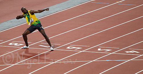 09 AUG 2012 - LONDON, GBR - Usain Bolt (JAM) of Jamaica celebrates winning the men's 200m final during the London 2012 Olympic Games athletics at the Olympic Stadium in Stratford, London, Great Britain (PHOTO (C) 2012 NIGEL FARROW)