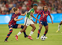 AUSTIN, TX - JUNE 16: Emily Sonnett #14 of the USWNT defends Rasheedat Ajibade #15 of Nigeria during a game between Nigeria and USWNT at Q2 Stadium on June 16, 2021 in Austin, Texas.