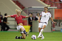 Norway midfielder (8) Solveig Gulbrandsen attempts a tackle on USA midfielder (10) Aly Wagner. The United States (USA) defeated Norway (NOR) 4-1 during the third place match of the Women's World Cup China 2007 at Shanghai Hongkou Football Stadium in Shanghai, China, on September 30, 2007.