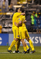 24 APRIL 2010:  Gino Padula of the Columbus Crew (4) hugs Guillermo Barros Schelotto after he scores on a penalty kick in the first half of the Real Salt Lake at Columbus Crew MLS soccer game in Columbus, Ohio. Columbus Crew defeated RSL 1-0 on April 24, 2010.