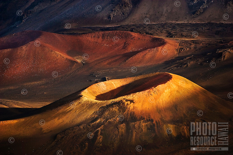 Two volcano craters inside Haleakala Crater at sunset on Maui