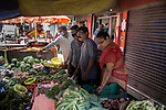 Indian people buy fruits and vegetables from an open air market during a 21 days total lockdown in the country. Government allowed people to go out and collect  raw food, groceries from the market in the morning from 9 AM TO 12 NOON. Kolkata, West Bengal, India. Arindam Mukherjee