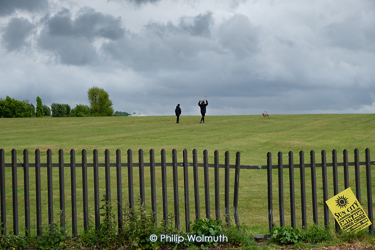 Dog walkers in Clitterhouse Recreation Ground, Barnet, London, during the Covid-19 pandemic lockdown.