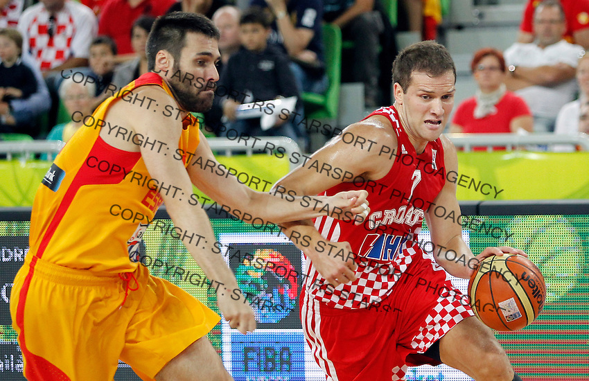 "German Gabriel of Spain (L) and Bojan Bogdanovic of Croatia (R) in action during European basketball championship ""Eurobasket 2013""  basketball game for 3rd place between Spain and Croatia in Stozice Arena in Ljubljana, Slovenia, on September 22. 2013. (credit: Pedja Milosavljevic  / thepedja@gmail.com / +381641260959)"