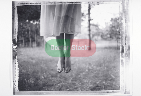 haunting image of woman's legs dangling in mid-air