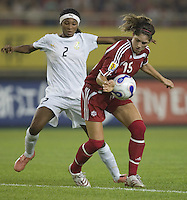 Canada foward (15) Kara Lang tries to turn around Ghana defender (2) Aminatu Ibrahim during their first round game at the 2007 FIFA Women's World Cup at Hangzhou Dragon Stadium in Hangzhou, China.  Canada defeated Ghana, 4-0.