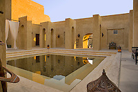 Dubai.  Inner courtyard and pool of Bab al Shams desert resort. .