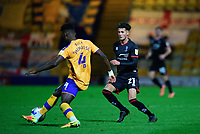 Mansfield Town's Rollin Menayese under pressure from Lincoln City's Jamie Soule<br /> <br /> Photographer Andrew Vaughan/CameraSport<br /> <br /> EFL Trophy Northern Section Group E - Mansfield Town v Lincoln City - Tuesday 6th October 2020 - Field Mill - Mansfield  <br />  <br /> World Copyright © 2020 CameraSport. All rights reserved. 43 Linden Ave. Countesthorpe. Leicester. England. LE8 5PG - Tel: +44 (0) 116 277 4147 - admin@camerasport.com - www.camerasport.com