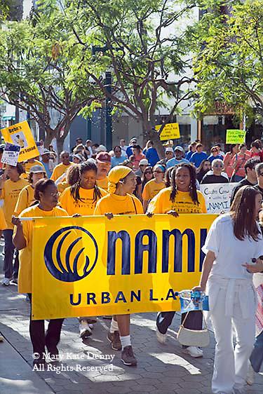 Urban Los Angeles NAMI _National Alliance for Mental Health_group carries sign at NAMI WALKATHON in October, Santa Monica, California