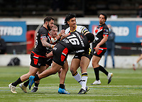 28th March 2021; Rosslyn Park, London, England; Betfred Challenge Cup, Rugby League, London Broncos versus York City Knights; Tyme Dow-Nikau of York City Knights tackled by Daniel Hindmarsh, Romain Navarrete and Jacob Jones of London Broncos