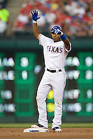 "Texas Rangers shortstop Elvis Andrus #1 gives his dugout ""the claw"" following his fourth inning double during the Major League Baseball game against the Texas Rangers at the Rangers Ballpark in Arlington, Texas on July 27, 2011. Minnesota defeated Texas 7-2.  (Andrew Woolley/Four Seam Images)"