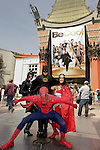 Actors costumed as superheroes pose in front of Grauman's Chinese Theater in Hollywood, CA