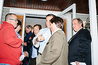 """Texas senator and Republican presidential candidate Ted Cruz speaks with a campaign worker after speaking at an event called """"Smoke a cigar with Ted Cruz"""" at a house party at the home of Linda & Steven Goddu Salem, New Hampshire. Cruz briefly smoked a cigar after speaking at the event."""