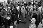 Teenage girls in crowd of people at the 1981 Notting Hill carnival 1980s UK