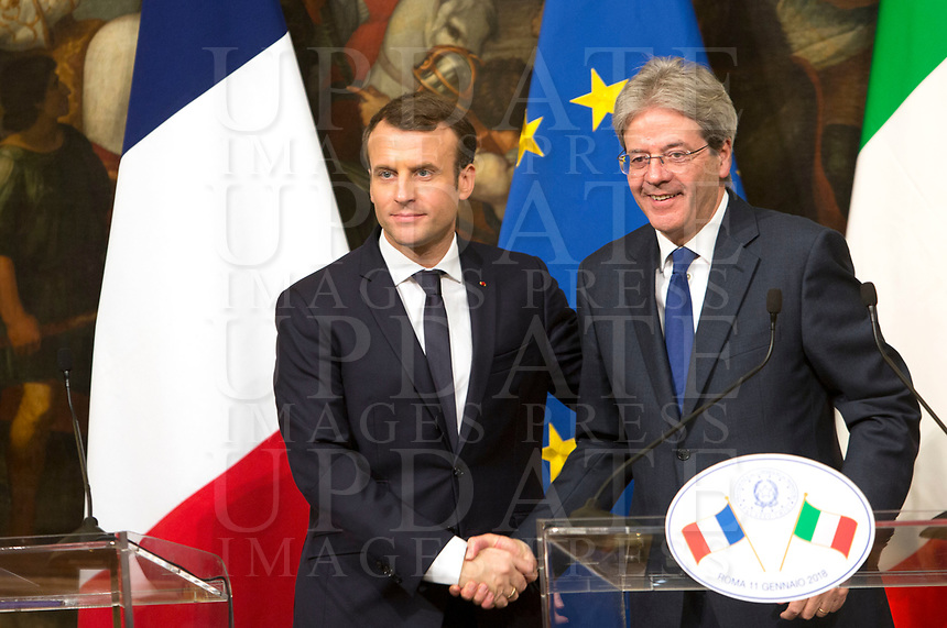 French President Emmanuel Macron, left, shakes hands with Italian Premier Paolo Gentiloni at the end of their joint press conference at Chigi Palace in Rome, January 11, 2018.<br /> UPDATE IMAGES PRESS/Riccardo De Luca<br /> <br /> ITALY OUT