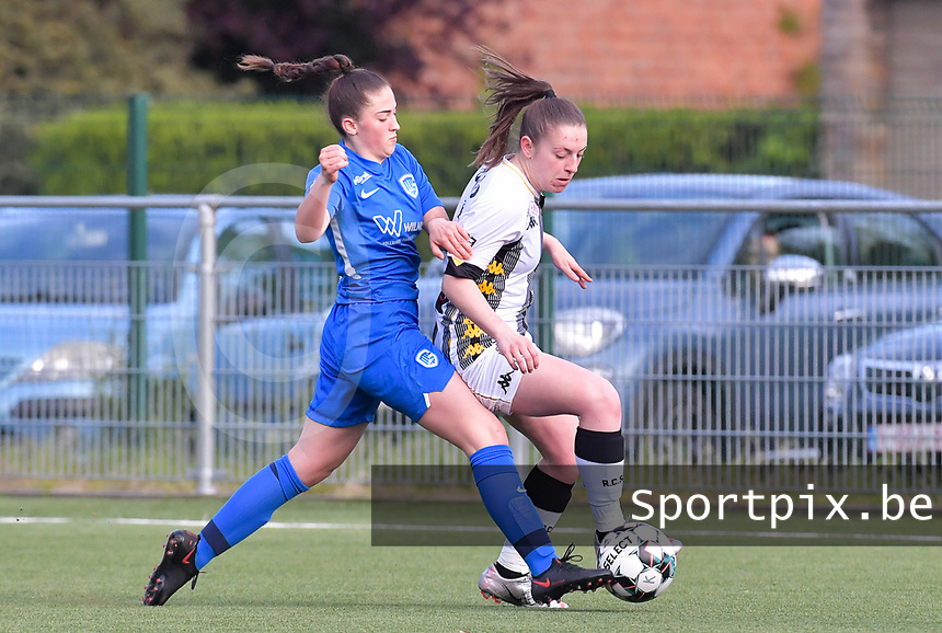 midfielder Emily Steijvers (33) of KRC Genk pictured fighting for the ball with Chrystal Lermusiaux (2) of Sporting Charleroi during a female soccer game between  Racing Genk Ladies and Sporting Charleroi on the 9 th matchday of play off 2 in the 2020 - 2021 season of Belgian Scooore Womens Super League , saturday 22 nd of May 2021  in Genk , Belgium . PHOTO SPORTPIX.BE   SPP   STIJN AUDOOREN