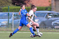 midfielder Emily Steijvers (33) of KRC Genk pictured fighting for the ball with Chrystal Lermusiaux (2) of Sporting Charleroi during a female soccer game between  Racing Genk Ladies and Sporting Charleroi on the 9 th matchday of play off 2 in the 2020 - 2021 season of Belgian Scooore Womens Super League , saturday 22 nd of May 2021  in Genk , Belgium . PHOTO SPORTPIX.BE | SPP | STIJN AUDOOREN