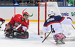 Sochi, RUSSIA - Mar 13 2014 - Corbin Watson watches as the puck gets by him with Brody Roybal beside him as Canada takes on USA in Sledge Hockey Semi-Final at the 2014 Paralympic Winter Games in Sochi, Russia.  (Photo: Matthew Murnaghan/Canadian Paralympic Committee)