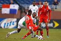 Panama midfielder Armando Cooper (11) shields the ball from Guadeloupe midfielder Gregory Gendrey (14) during the CONCACAF soccer match between Panama and Guadeloupe at Ford Field Detroit, Michigan.