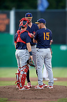 State College Spikes pitcher Adrian Martin (15) talks with starting pitcher Jim Voyles (44) and catcher Matt Duce (8) during a game against the Batavia Muckdogs on July 9, 2018 at Dwyer Stadium in Batavia, New York.  State College defeated Batavia 3-0.  (Mike Janes/Four Seam Images)