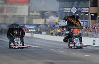 Feb. 19, 2012; Chandler, AZ, USA; NHRA top fuel dragster driver Doug Kalitta (left) races alongside Bob Vandergriff Jr during the Arizona Nationals at Firebird International Raceway. Mandatory Credit: Mark J. Rebilas-