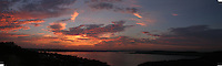 This spectacular Lake Travis sunset features a spectacular display of orange and pink clouds over the water