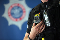 "One of the AXON bodycams held by a firearms police officer. Wednesday 17 May 2017<br /> Re: Body worn video cameras are being introduced into the South Wales Police force as part of operational equipment and will be rolled out over the next few months.<br />  Forces across the UK are using this technology and integrating it into daily policing activities.  Body worn video may be used in court as evidence and for investigative purposes, including complaints against police or as a training material for police. <br />  Other forces have seen a range of benefits from using body worn video to support their general patrolling and investigative tasks. These benefits include:<br /> Gathering and presentation of evidence<br /> Changing the behaviour of offenders<br /> Lower incidence or escalation of violence<br /> Increased guilty pleas by defendants<br /> Increased time on patrol and less time spent on paperwork<br /> Improved public co-operation and interactions with police<br /> Improved transparency and accountability<br /> Professionalising police interaction<br /> Assistant Chief Constable Richard Lewis said: ""Equipping our officers with body worn cameras is the start of a new way we capture, utilise and share digital evidence.  The technology is very exciting and will assist officers and staff in doing their jobs, it will ensure that we are more accountable to the public that we serve and in turn build trust with our communities."