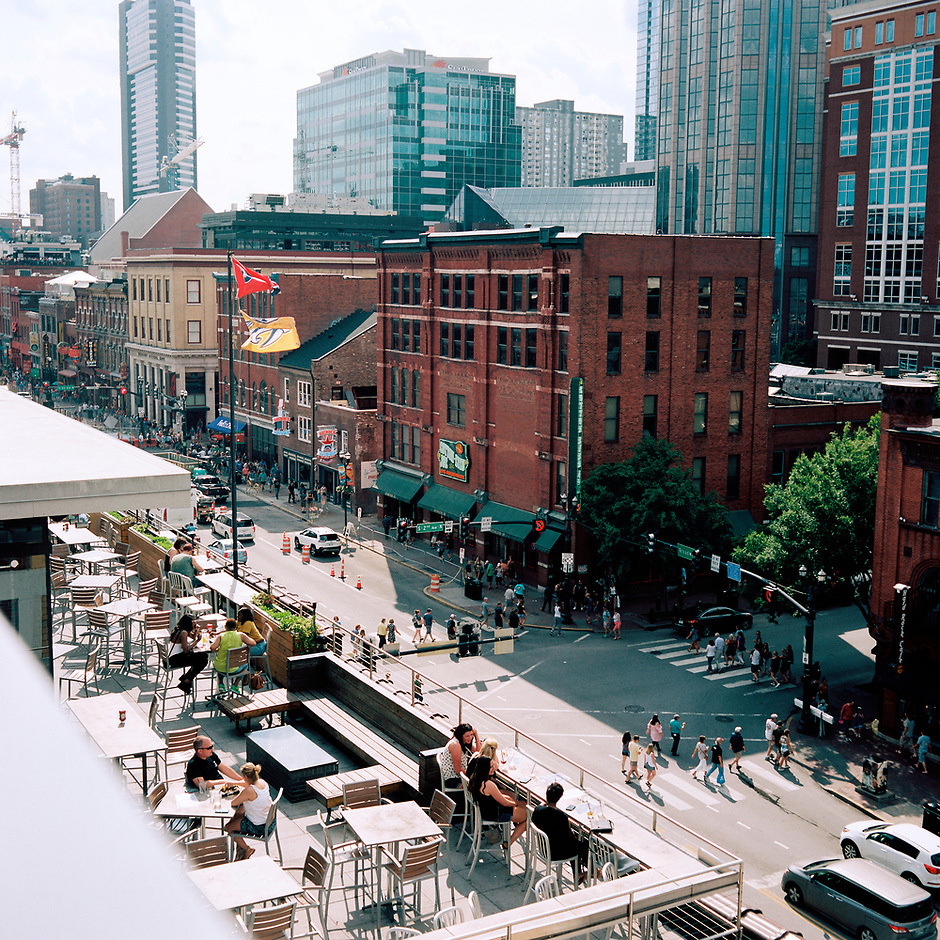Lower Broadway, Nashville, Tennessee's honky tonk district, is pictured from a rooftop on Saturday, May 19, 2018. (Photo by James Brosher)