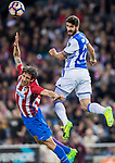 Raul Rodriguez Navas (R) of Real Sociedad fights for the ball with Stefan Savic (C) of Atletico de Madrid during their La Liga match between Atletico de Madrid vs Real Sociedad at the Vicente Calderon Stadium on 04 April 2017 in Madrid, Spain. Photo by Diego Gonzalez Souto / Power Sport Images