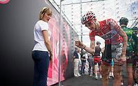 Tim Wellens (BEL/Lotto-Belisol) signing in<br /> <br /> 2014 Giro d'Italia <br /> stage 17: Sarnonico - Vittori Veneto (208km)