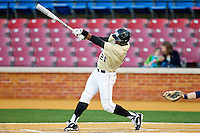 Kevin Jordan #21 of the Wake Forest Demon Deacons follows through on his swing against the Georgetown Hoyas at Wake Forest Baseball Park on February 26, 2012 in Winston-Salem, North Carolina.  The Demon Deacons defeated the Hoyas 5-2.  (Brian Westerholt / Four Seam Images)