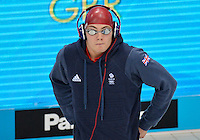July 28, 2012: Craig Benson of Great Britain arrives on deck to compete in Men's 100 meter Butterfly semifinal event at the Aquatics Center on day one of 2012 Olympic Games in London, United Kingdom.