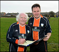BNPS.co.uk (01202 558833)<br /> Pic: TomWren/BNPS<br /> <br /> Pictured: Portland Town FC's club secretary Colin Judge snaps up the signature of Dickie Borthwick in 2016. <br /> <br /> He thinks it's all over - but it's not yet..<br /> <br /> Britain's oldest footballer Dickie Borthwick is vowing to overcome an injury that is threatening to end his 77 year career. <br /> <br /> The 85-year-old, who still plays Sunday league football, has been sidelined by a trapped nerve in his back for three months. <br /> <br /> He is giving himself until August to see if he can recover from the injury and get back playing again but will reluctantly hang up his boots if he can't.