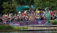 04 AUG 2012 - LONDON, GBR - Spectators watch as the race leaders make their way round the run course of the women's London 2012 Olympic Games Triathlon in Hyde Park in London, Great Britain (PHOTO (C) 2012 NIGEL FARROW)