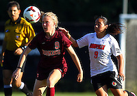 WINSTON-SALEM, NORTH CAROLINA - August 30, 2013:<br />  Charlyn Corral (9) of Louisville University moves up on Kelsey Loupee (9) of Virginia Tech during a match at the Wake Forest Invitational tournament at Wake Forest University on August 30. The game ended in a 1-1 tie.