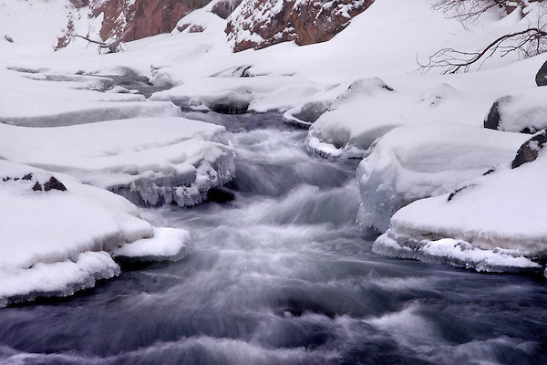 Snow covered Clear Creek in Clear Creek Canyon west of Golden and Denver, Colorado, USA .  John leads private photo tours in Boulder and throughout Colorado. Year-round Boulder photo tours.
