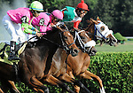 10 September 06: Prior to the running of the feature Hopeful Stakes for two year olds, Javier Castellano rides Frivolous Buck (no. 5, center) to victory in a three horse photo finish in the 8th race at Saratoga Race Track in Saratoga Springs, New York.