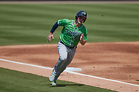 Travis Snider (26) of the Gwinnett Stripers rounds third base during the game against the Charlotte Knights at Truist Field on May 9, 2021 in Charlotte, North Carolina. (Brian Westerholt/Four Seam Images)