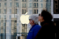 NEW YORK, NEW YORK - MARCH 10: People walk in front an Apple store on March 10, 2021, in New York. The Nasdaq Composite continued falling more than half a percent during the day also the move away from Apple Inc, Amazon.com Inc , Facebook Inc, Tesla Inc and Microsoft Corp, falling during the day, helped small-cap stocks rise more than double the gains of the S&P 500. (Photo by John Smith/VIEWpress)