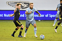KANSAS CITY, KS - OCTOBER 11: Johnny Russell #7 of Sporting Kansas City goes past Dax McCarty #6 of Nashville SC during a game between Nashville SC and Sporting Kansas City at Children's Mercy Park on October 11, 2020 in Kansas City, Kansas.