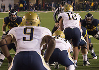 A view from the Pitt backfield of WVU linebackers.  The WVU Mountaineers beat the Pitt Panthers 21-20 at Mountaineer Field in Morgantown, West Virginia on November 25, 2011.