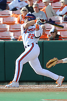 Catcher Spencer Kieboom #22 of the Clemson Tigers swings at a pitch during  a game against the North Carolina Tar Heels at Doug Kingsmore Stadium on March 9, 2012 in Clemson, South Carolina. The Tar Heels defeated the Tigers 4-3. Tony Farlow/Four Seam Images.