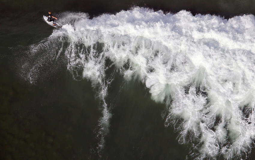 MANASQUAN, NJ - (Sept. 13, 2013) - Manasquan native Pat Schmidt, 19, rides a huge September swell at Manasquan Inlet.
