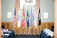 The American flag and various military flags stand in a hallway before Texas senator and Republican presidential candidate Ted Cruz speaks at a town hall put on by the Concerned Veterans for American at Milford Town Hall in Milford, New Hampshire.