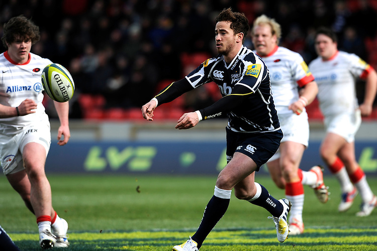 20130310 Copyright onEdition 2013©.Free for editorial use image, please credit: onEdition..Danny Cipriani passes during the LV= Cup semi final match between Sale Sharks and Saracens at the Salford City Stadium on Sunday 10th March 2013 (Photo by Rob Munro)..For press contacts contact: Sam Feasey at brandRapport on M: +44 (0)7717 757114 E: SFeasey@brand-rapport.com..If you require a higher resolution image or you have any other onEdition photographic enquiries, please contact onEdition on 0845 900 2 900 or email info@onEdition.com.This image is copyright onEdition 2013©..This image has been supplied by onEdition and must be credited onEdition. The author is asserting his full Moral rights in relation to the publication of this image. Rights for onward transmission of any image or file is not granted or implied. Changing or deleting Copyright information is illegal as specified in the Copyright, Design and Patents Act 1988. If you are in any way unsure of your right to publish this image please contact onEdition on 0845 900 2 900 or email info@onEdition.com