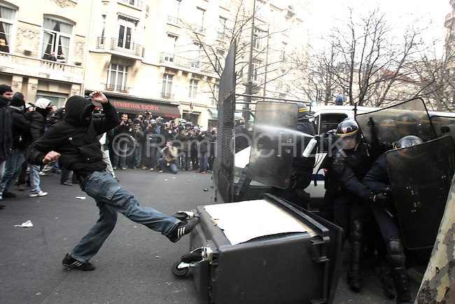 """©REMI OCHLIK/IP3; PARIS, FRANCE LE 17/03/06 - HEURTS ENTRE CRS ET ETUDIANTS ANTI CPE A LA FIN DE LA MANIFESTATION DE JEUDI - ....Fighting between anti riots police and french students around the universite la sorbonne in paris..The contrat premiere embauche (CPE), translated first employment contract, was a new form of employment contract pushed in spring 2006 in France by Prime Minister Dominique de Villepin. This employment contract, available solely to employees under 26, would have made it easier for the employer to fire employees by removing the need to provide reasons for dismissal for an initial """"trial period"""" of two years, in exchange for some financial guarantees for employees. ....The law has met heavy resistance from students, trade unions, and left-wing activists, sparking protests in February and March 2006 (and continuing into April) with hundreds of thousands of participants in over 180 cities and towns across France"""