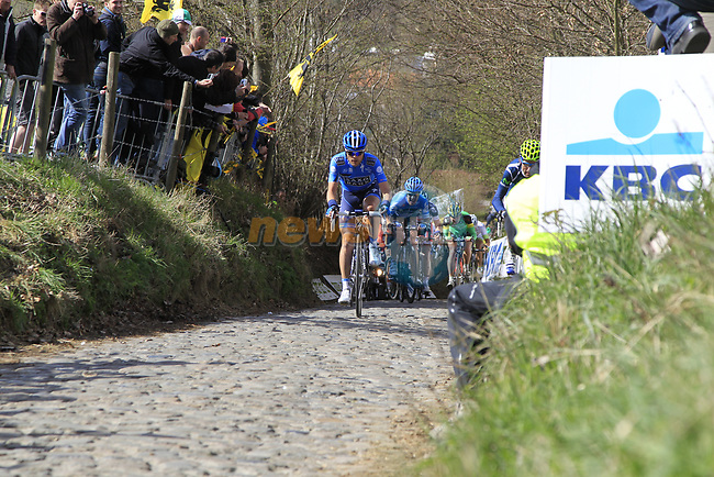 The breakaway group led by Anders Lund (DEN) Saxo Bank and Pablo Lastras Garcia (ESP) Movistar Team climb Koppenberg during the 96th edition of The Tour of Flanders 2012, running 256.9km from Bruges to Oudenaarde, Belgium. 1st April 2012. <br /> (Photo by Eoin Clarke/NEWSFILE).
