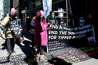 NEW YORK, NEW YORK - MARCH 08: People hold placards during a protest on International Women's Day on March 08, 2021 in New York. Women were demanding a fair wage and the end of gender violence at work in front of Governor Andrew Cuomo office in the big apple. (Photo by John Smith/VIEWpress)
