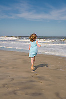 Child running on the beach, New Jersey